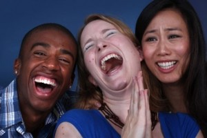 Three laughing people