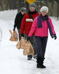 One, two, three folks help carry a strangers groceries.